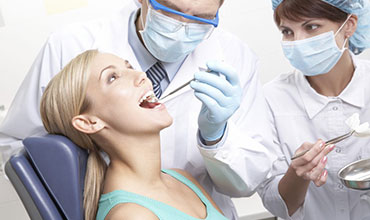 A woman having her teeth checked