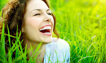 Smiling woman in a green field